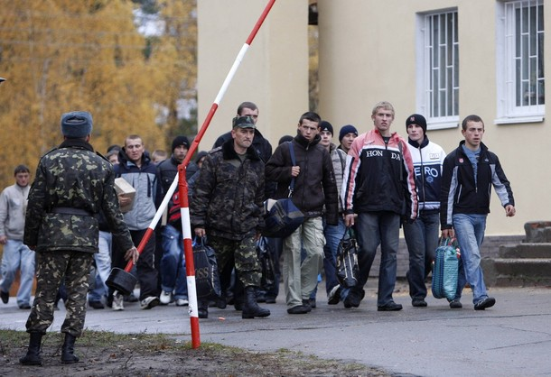 Ukrainian conscripts arrive at a military training centre, the biggest in the former Soviet Union, in the village of Oster, some 90 km (56 miles) from the capital Kiev, October 29, 2009. About 19,500 thousand recruits were called up to the Ukrainian army this autumn.