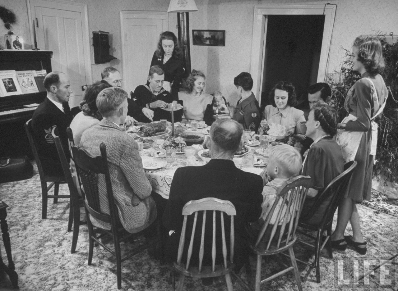 James Ferdinand Irwin family sitting around table having Christmas dinner, their young men safely returned fr. WWII, (clockwise fr. L) Fred Andrews, Mr. Irwin, Jim, unident., Jeanne, Joe, Levern Love, Myra Lee, Jack, unident., Mrs. Irwin Scotty, and 2 un.ident.© Time Inc. Myron Davis